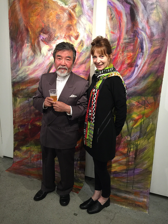Susan Falk is toasted by JARFO gallery's Jo Ishida, during the opening of her exhibit RED- Circle of Life in Kyoto, Japan last month. Despite the logistical challenges of transporting several massive works of art across the Pacific, the Langley painter knew she had to represent Canada on a grand scale.— Image Credit: Submitted Photo