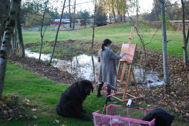 Susan painting on her farm